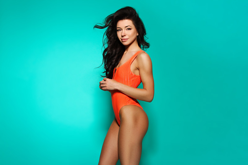 slim and trim woman in orange swimsuit