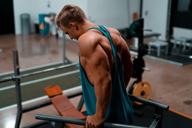 Man with muscles working out in the gym