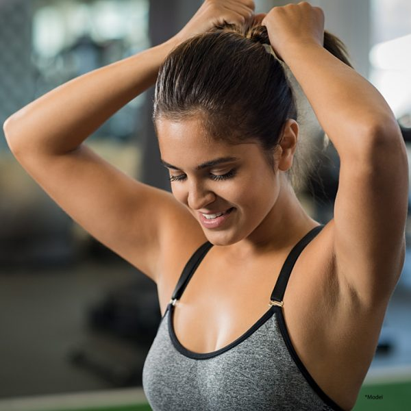 young women in sports bra and toned arms